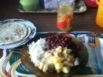 Chicken and potatoes, rice, beans, calala (passionfruit) juice