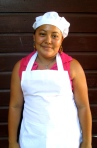 Carolina Hernandez Age 19, Cooking class. Her dream is to get a degree in business administration and have her own cake-making business
